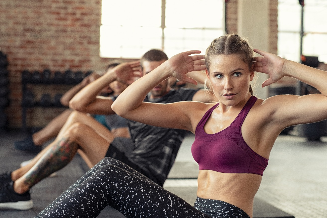 Woman doing abs exercise at cardio course jpg